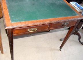 Edwardian mahogany 2 draw leather top writing table on tapered supports and with brass handles