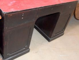 Dark stained clerks pedestal desk with covered top surface and adjustable shelf cupboards