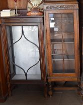 Edwardian mahogany display case of smaller proportion together with another with adjustable shelves.