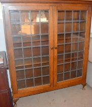Oak leaded glass adjustable shelf bookcase on stub legs 150x130x45cm