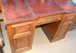 Mahogany leather top clerks desk with fitted draws behind a cupboard door and adjustable shelf to