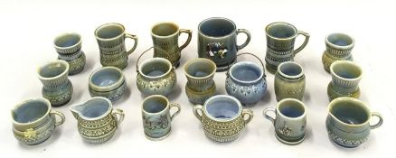 A quantity of Wade miniatures to include mugs, jugs etc.