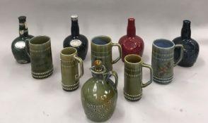 A quantity of wade porcelain whiskey bottles, beer mugs, jugs etc