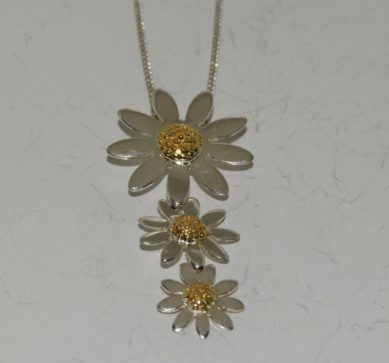 Designer Daisy gold on 925 silver pendant.