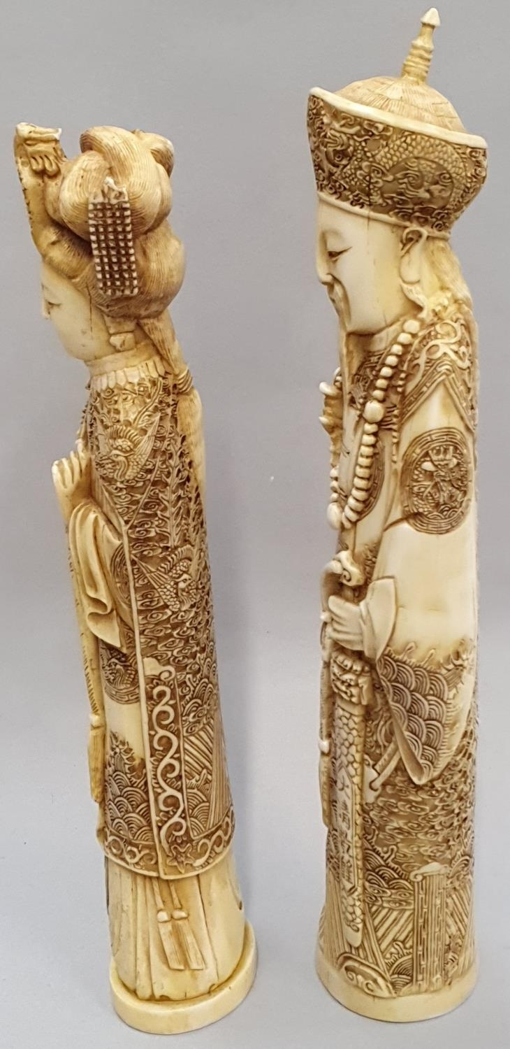 A pair of ivory coloured oriental figures 32 and 29cm high. - Image 2 of 8