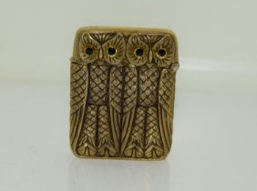 A brass cased double owl vesta case.