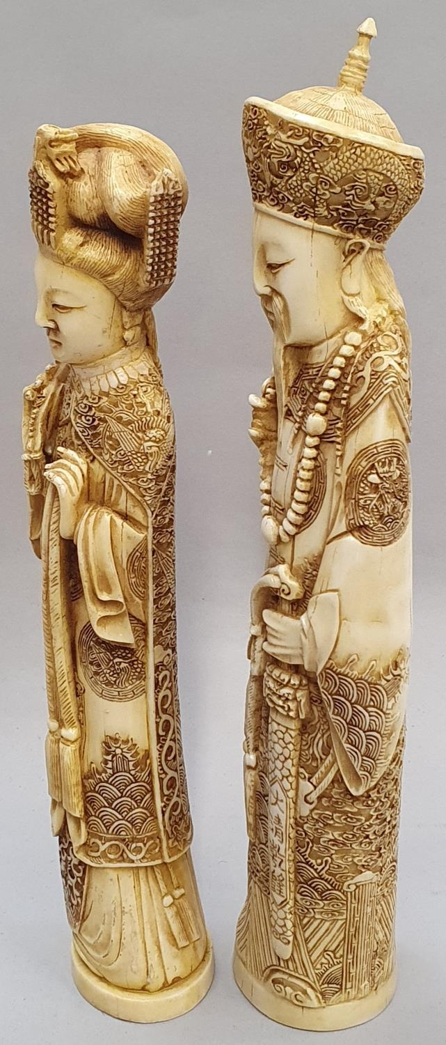 A pair of ivory coloured oriental figures 32 and 29cm high. - Image 7 of 8
