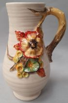 Clarice Cliff single handled water jug signed to the base 21cm high.