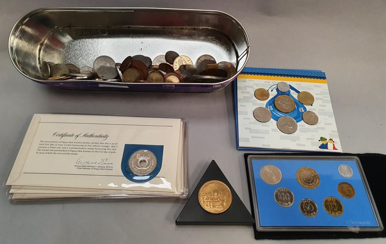 A collection of foreign coins, some uncirculated.