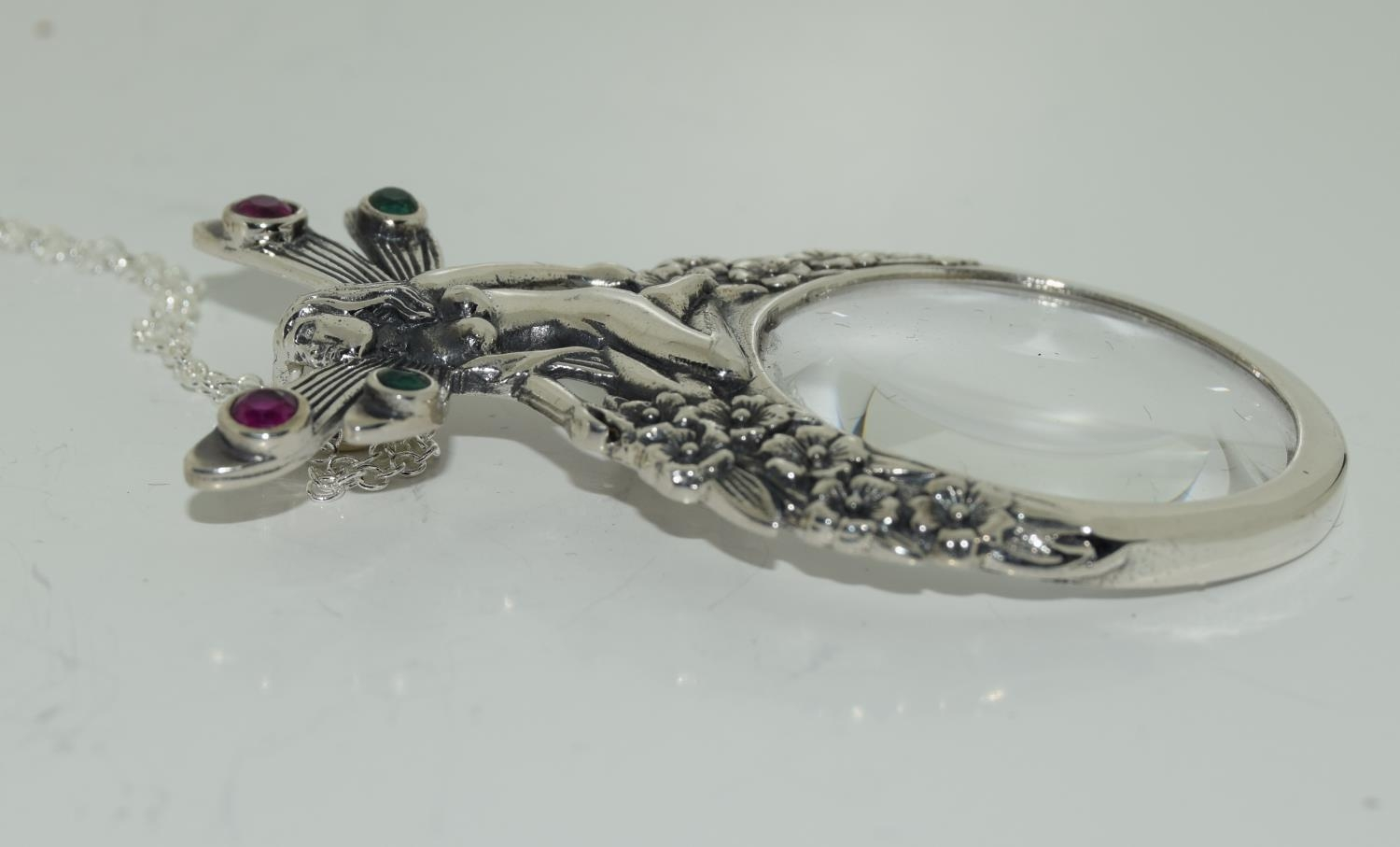 A silver magnifying glass pendant necklace with fairy finial set with Rubies. - Image 2 of 3