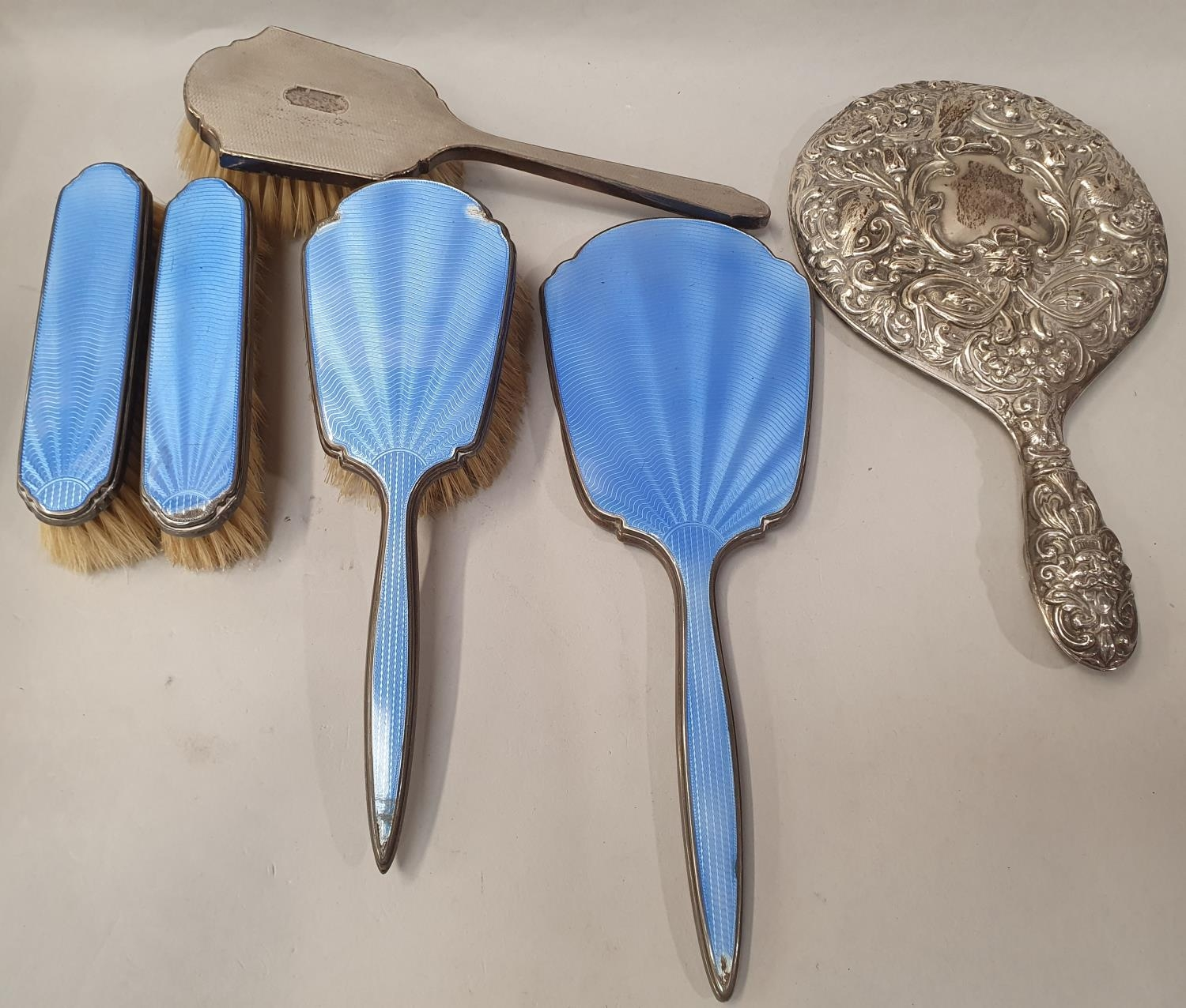 Collection of silver dressing table brushes.