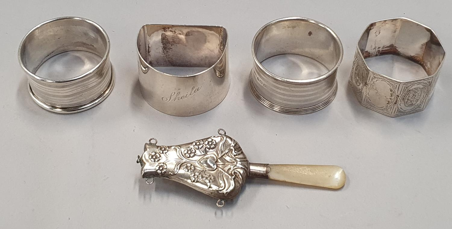 4 silver napkin rings together a baby rattle