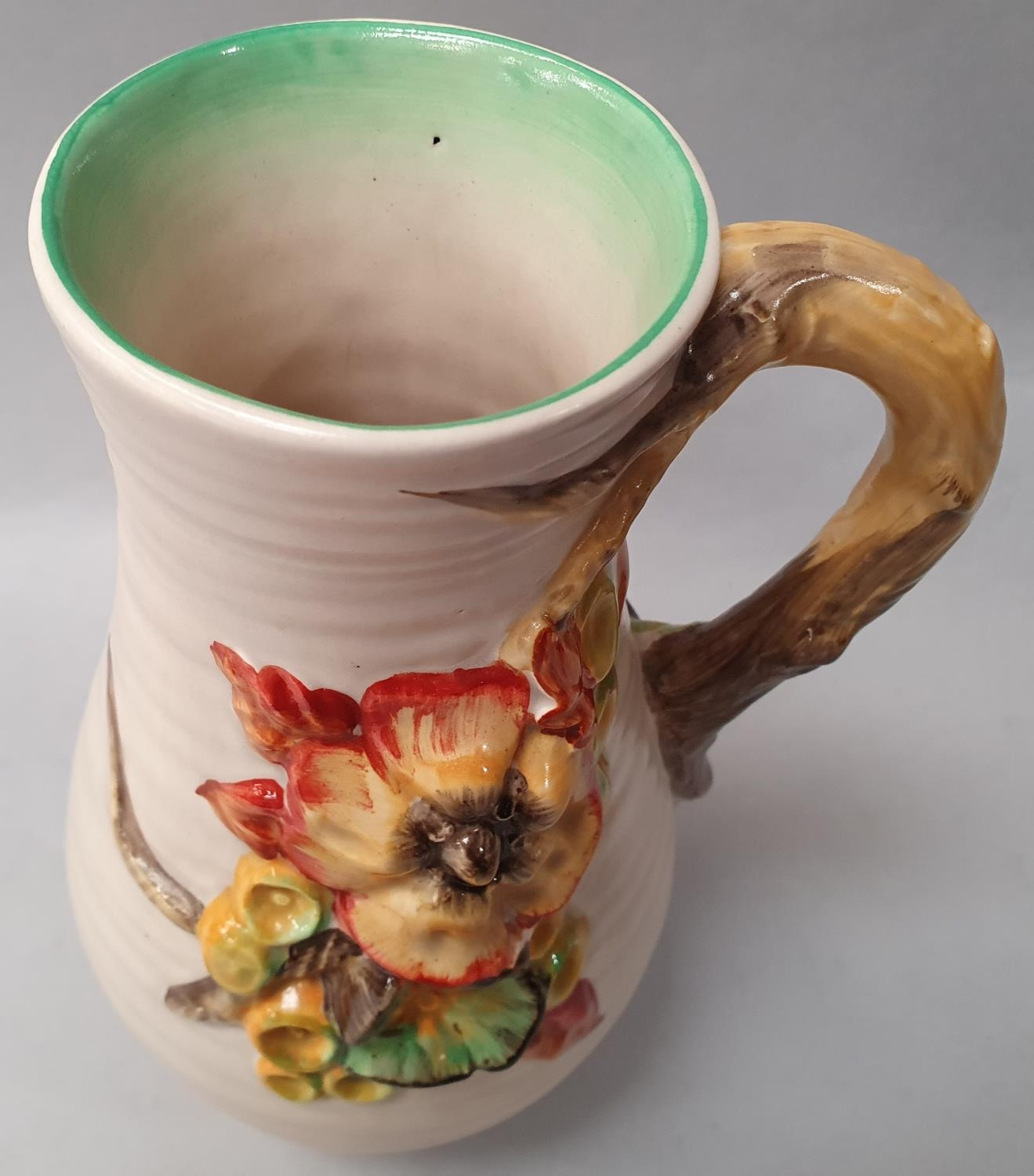 Clarice Cliff single handled water jug signed to the base 21cm high. - Image 2 of 7