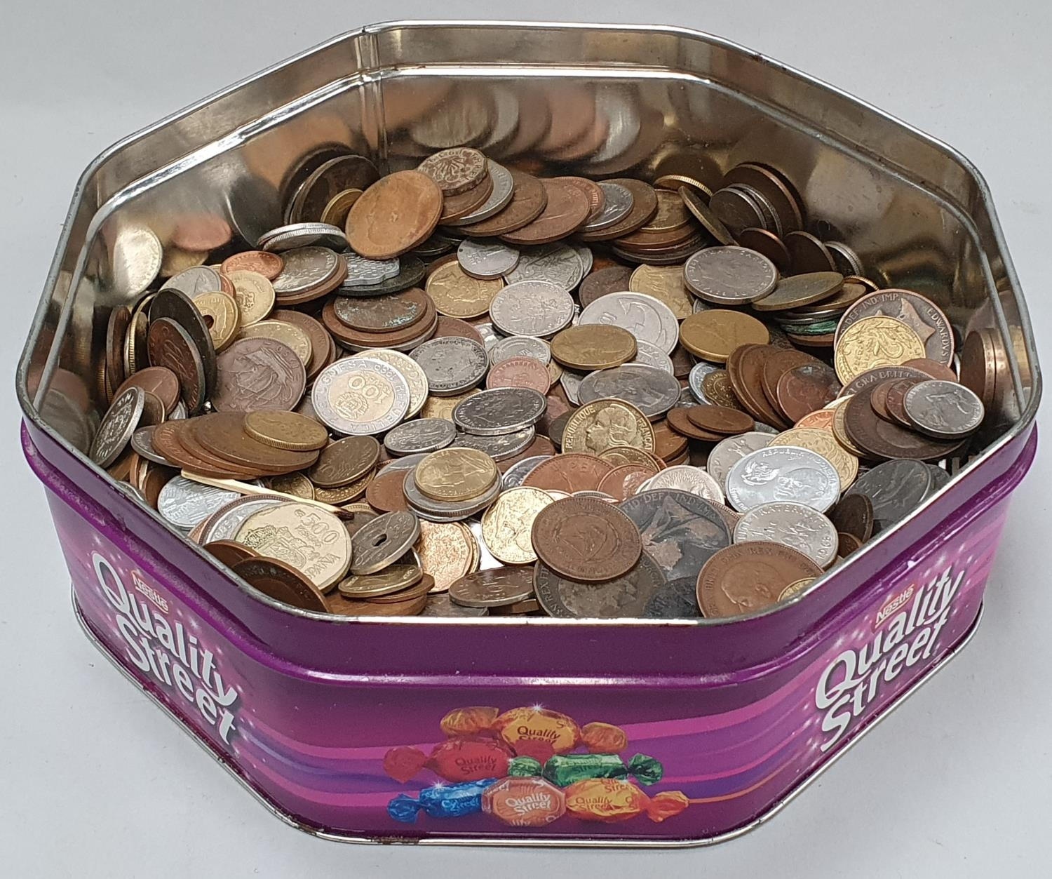 Purple tin of mixed coinage.