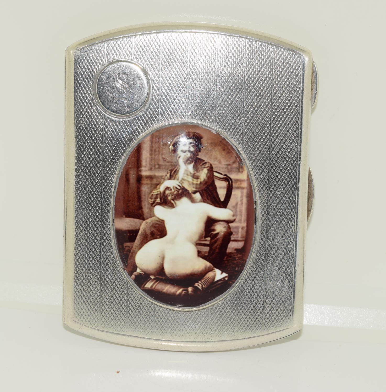 A silver case 1923 with semi nude enamel plaque.