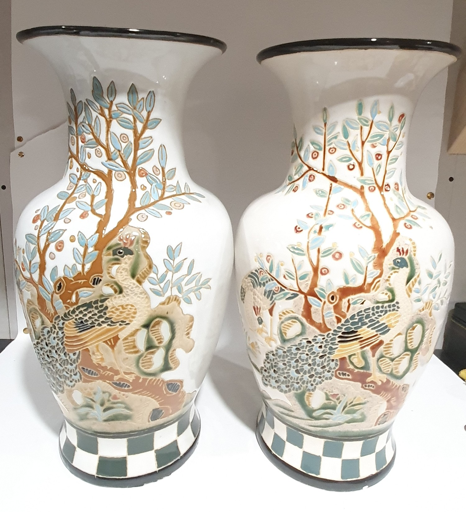 A pair of large oriental vases with tree and peacock decoration. 50cm high. Statement interior