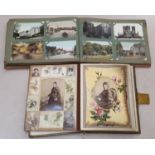 Victorian musical photo album together with an album of early colour and black and white postcards.