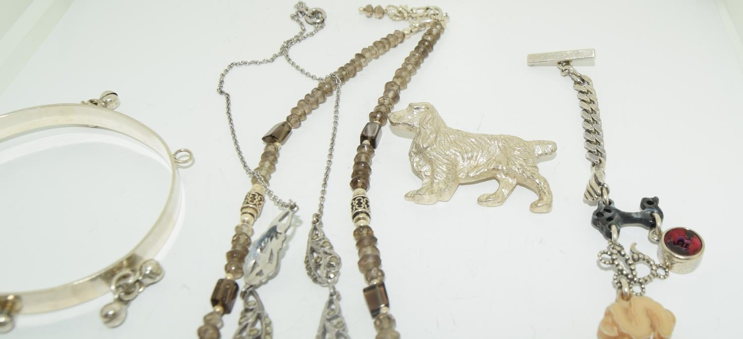 Interesting qty of silver and other jewellery to include a bracelet ,necklace , locket amber set