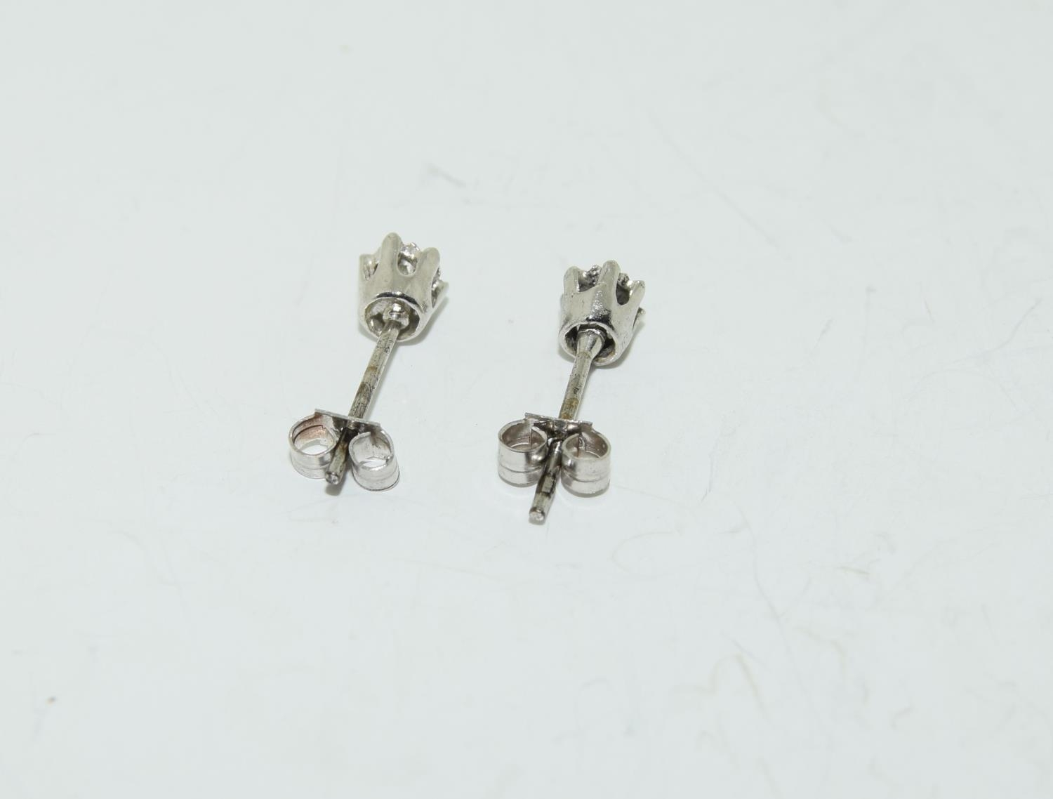 A pair of white gold diamond stud earrings. - Image 4 of 4