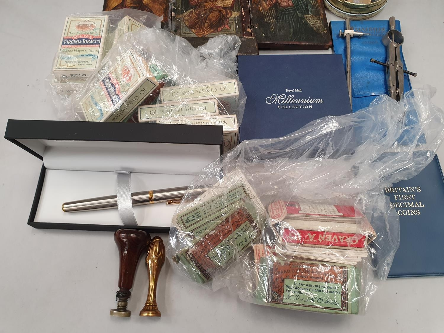 A 3 fold Icon, a Bulkam Sobrane Tobaco tin, various sets of Players cigarette cards and two seals. - Image 3 of 4