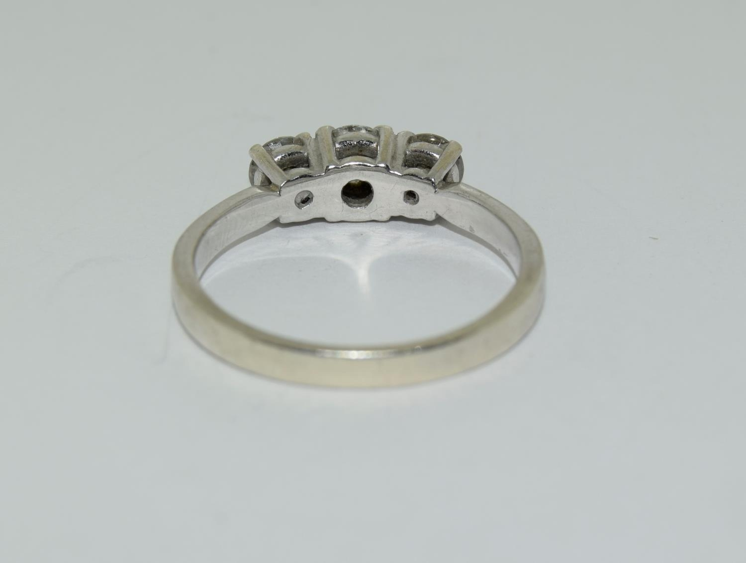 A Mosonite (dia.) three stone aprox 65 point 9ct white gold ring, Size O. - Image 3 of 6