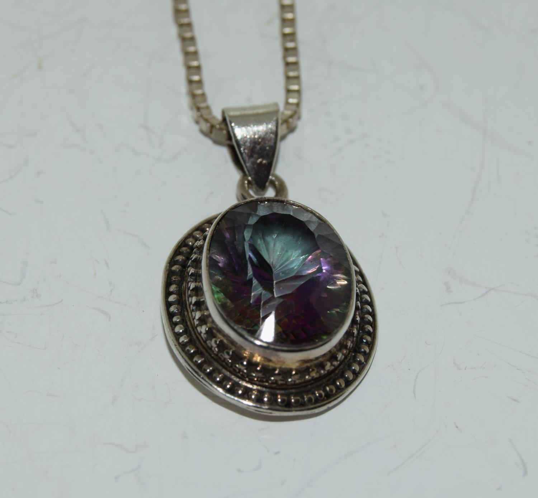 A large vintage mystic Topaz 925 silver pendant.