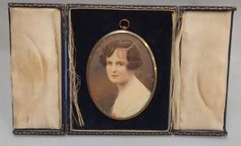 A miniature portrait of a lady in a fitted envelope shape picture frame, portrait 11x8cm