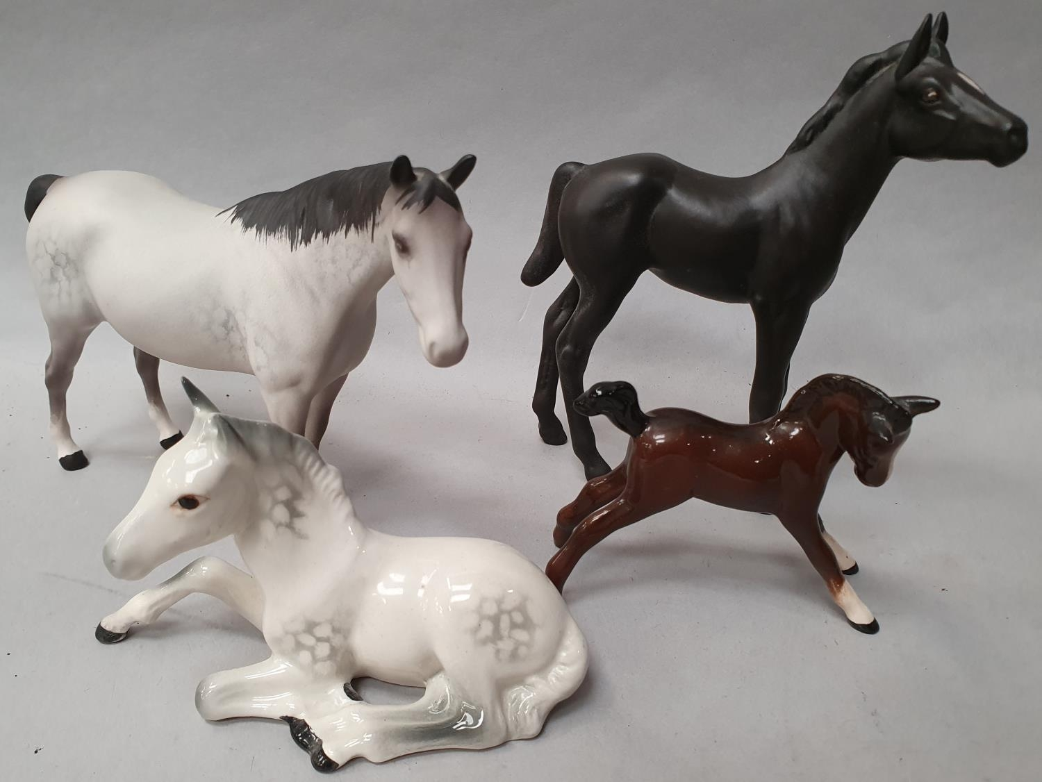 Four assorted Beswick horses.