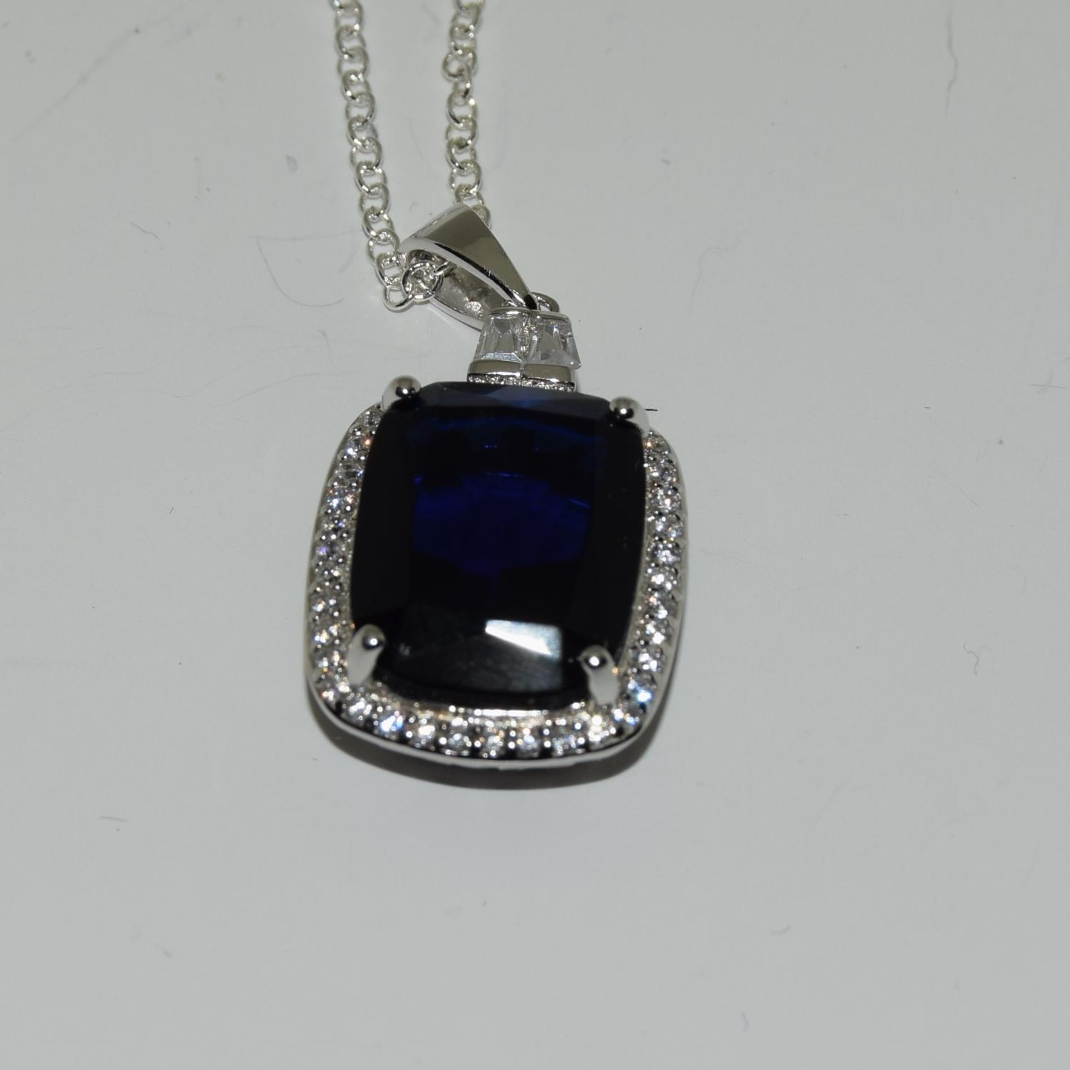 A silver CZ and Faux Sapphire pendant necklace (cased).