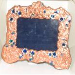 A copper and enamel art nouveau style picture frame.