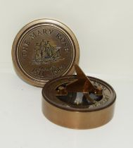 A brass compass and sundial.