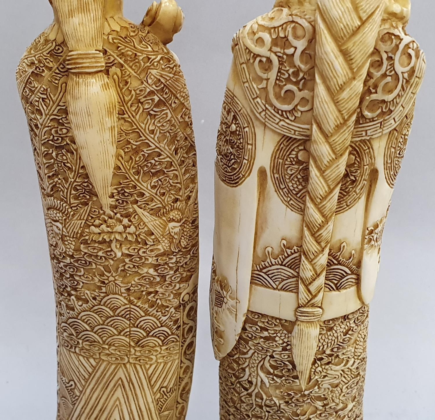A pair of ivory coloured oriental figures 32 and 29cm high. - Image 6 of 8