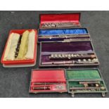 Box of vintage flutes.