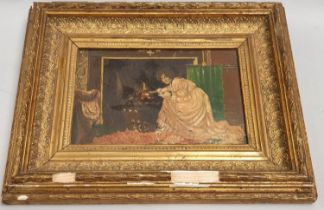 Gilt framed oil on board of a lady by a fireplace. 27.5 x 34.5cm.