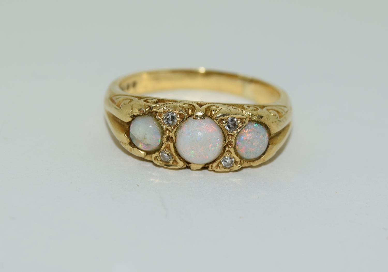 Opal/Diamond 3 stone 18ct gold heavy 6.6g ring, Size P.