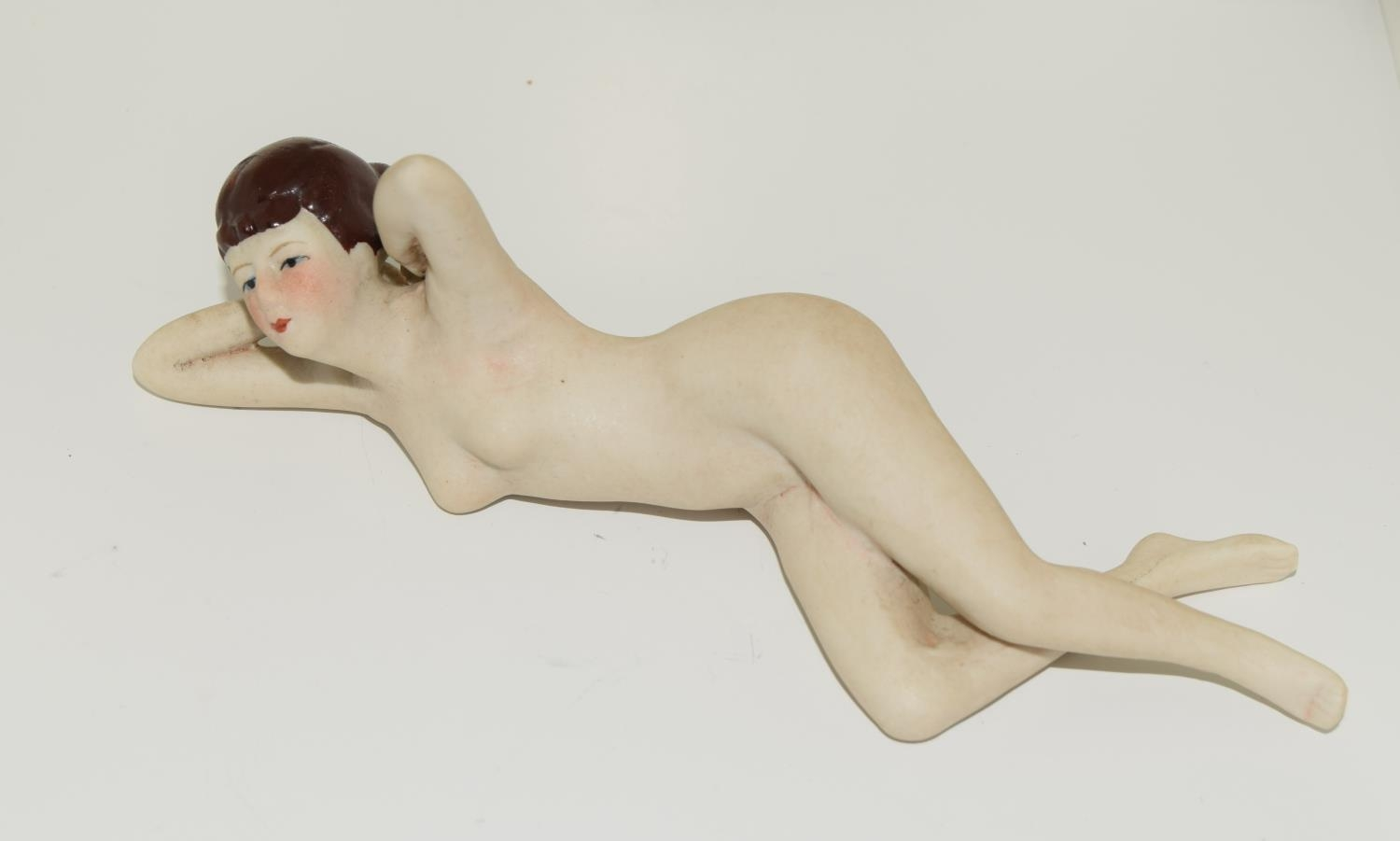 A Nude figure of a flapper girl.