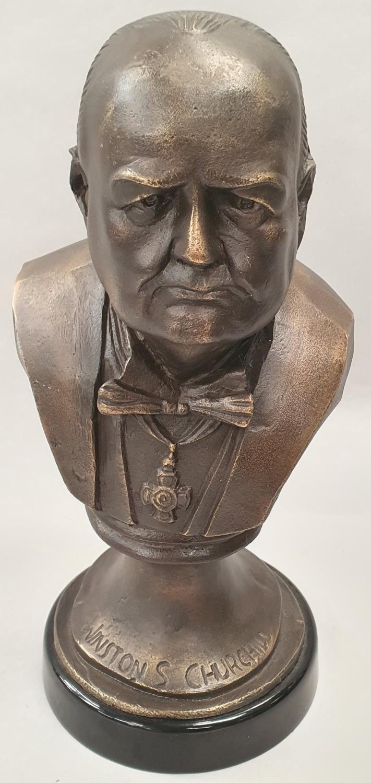 A cast metal bust of Winston Churchill on metal base 33cm tall.