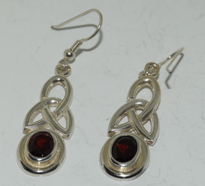 Large Celtic designed Garnet drop 925 silver earrings.