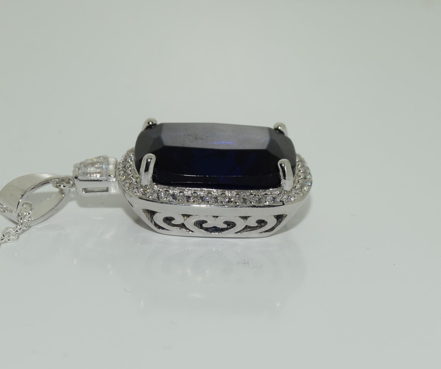 A silver CZ and Faux Sapphire pendant necklace (cased). - Image 2 of 3