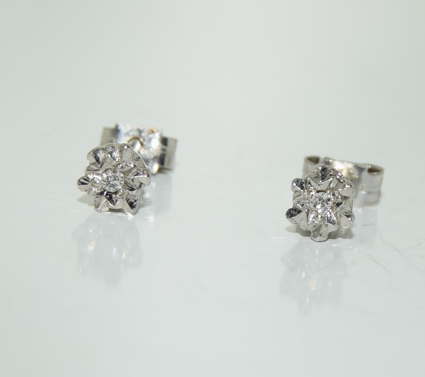 A pair of white gold diamond stud earrings. - Image 2 of 4