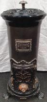 Antique cast iron log burner marked Deville & Co. Charleville 1278. Approx 75cm high.