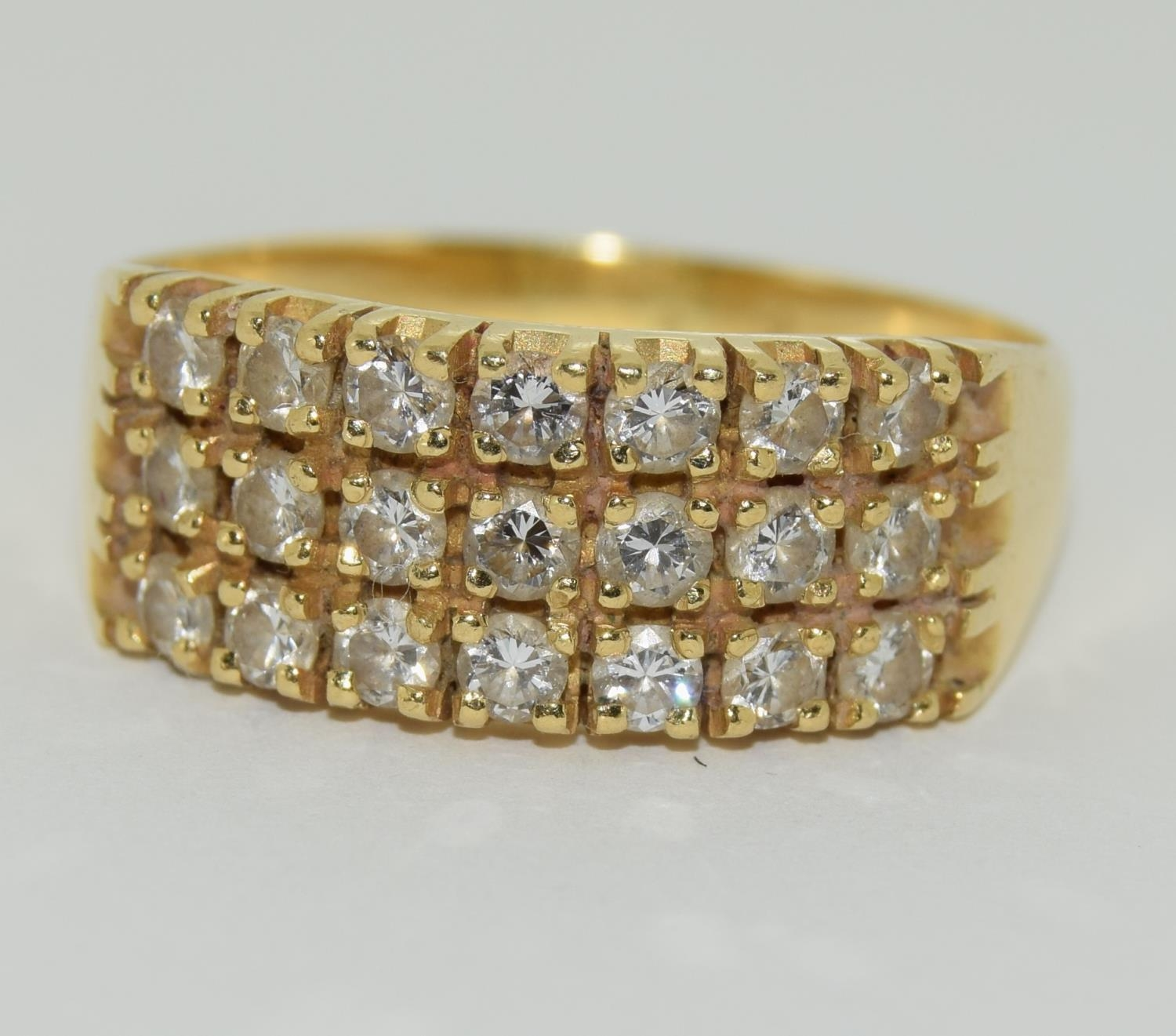 A Heavy 0.75ct three row diamond and 18ct yellow gold ring. 5.1 grams, Size R