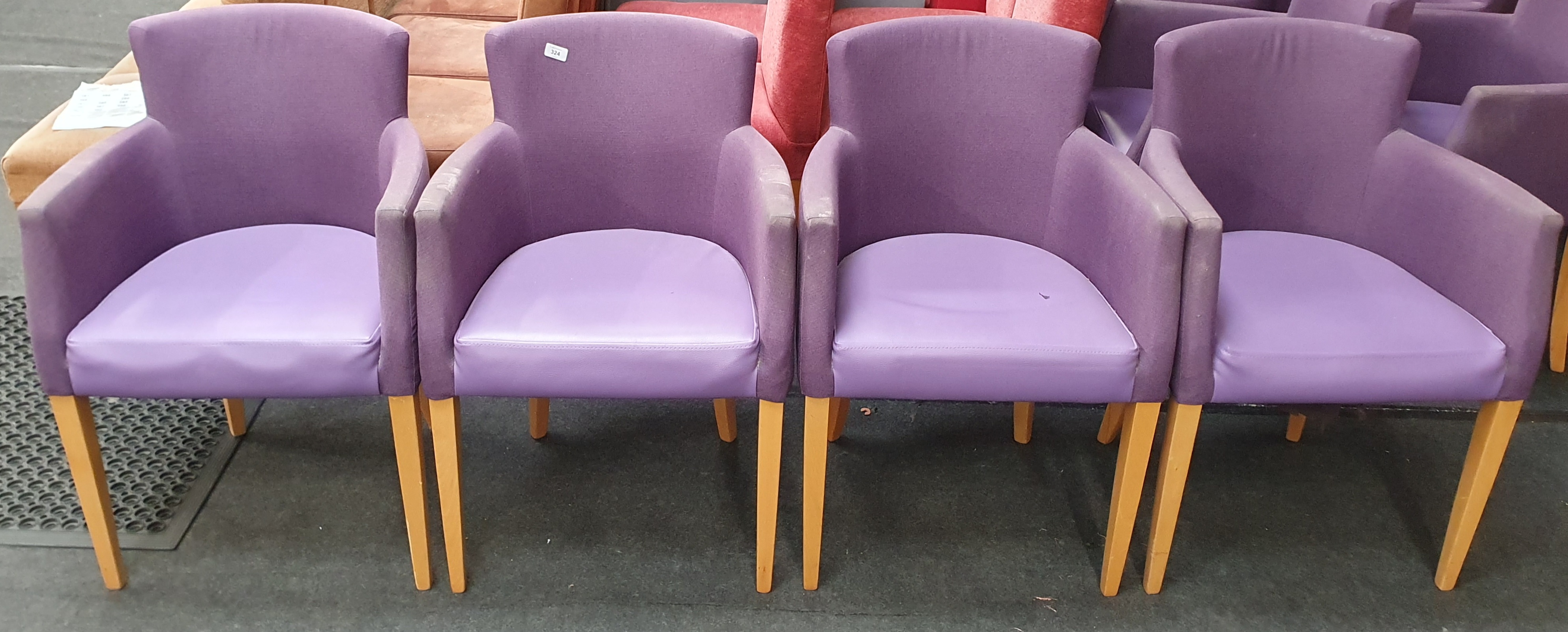 From a hotel clearance: Four lobby chairs in purple.