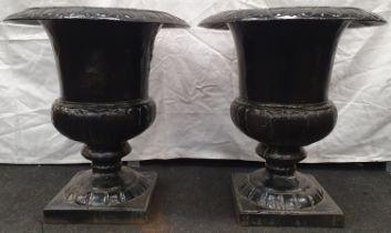 A pair of black painted cast iron Griechen style garden urns 59cm high 52cm diameter.