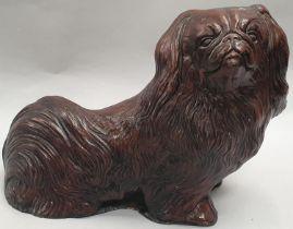 Pekingese dog figure.