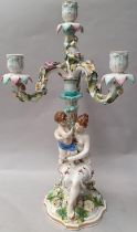 Porcelain Dresden three arm candelabra depicting a mother and child, 49cm tall.