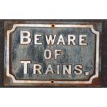"""Beware of Trains"" cast metal sign 21x31cm."