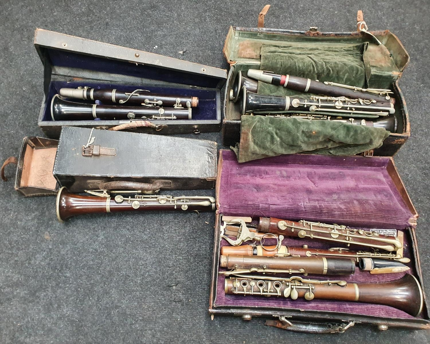 Case of vintage clarinets.