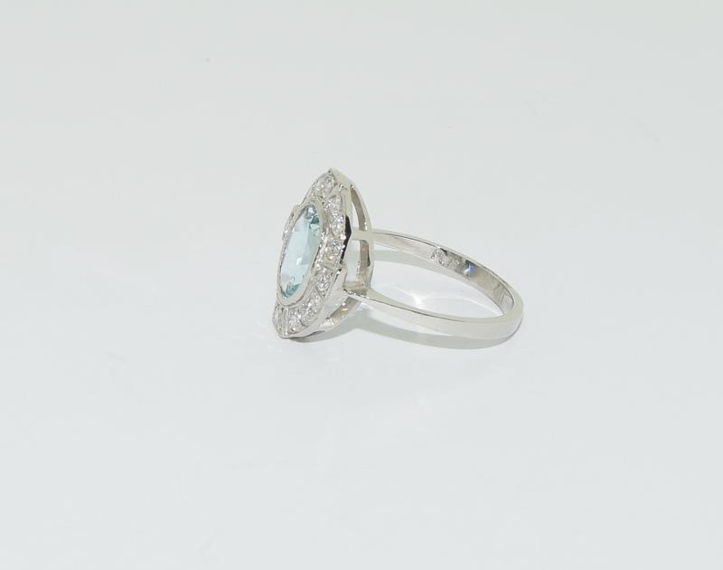 A Platinum aquamarine and diamond ring, Size M - Image 4 of 6