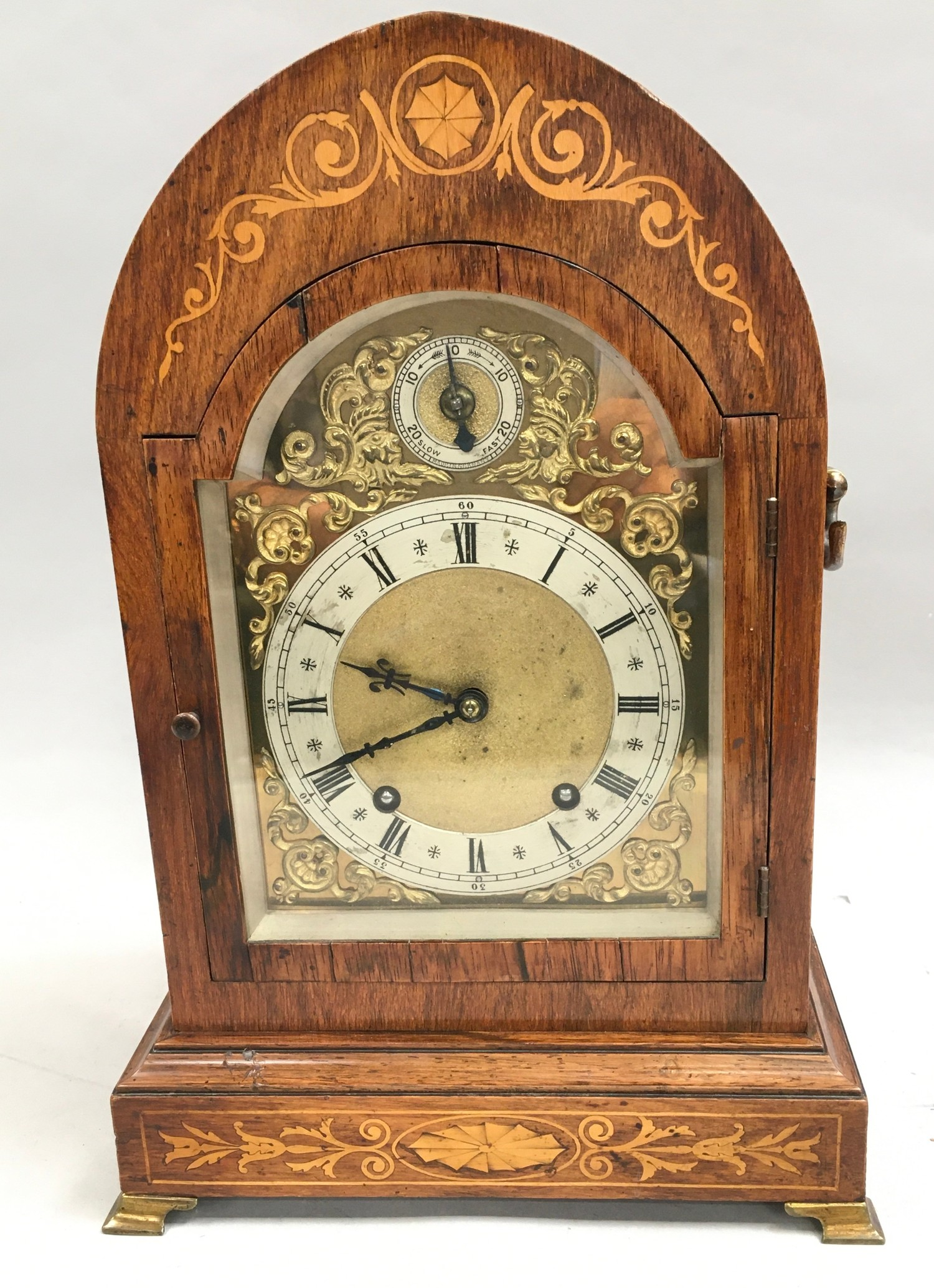Edwardian in laid dome shape striking mantle clock,with brass face on brass feet and side carrying